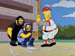 Homer Simpson wins the game for Springfield.