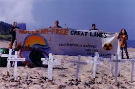 Protestors outside the Palisades reactor (in background) in 2000. Palisades has long been controversial; its future  may not be long. Photo by Michael Mariotte