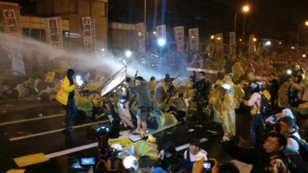 Police use water cannons on anti-nuclear protestors conducting a die-in in Taiwan in April. The protests led to suspension of construction of Taiwan's fourth nuclear reactor.