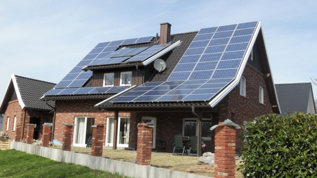 A solar-powered house in Germany. There are three homes newly solar-powered in my small city; how many are there in your community?