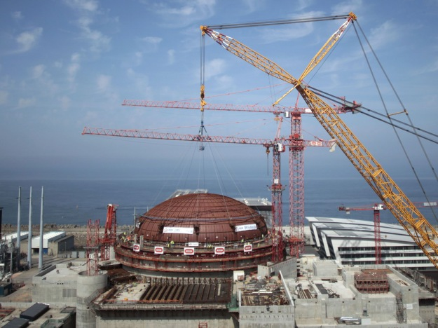 Installation of the reactor dome at Areva's EPR reactor at Flamanville, France. Now, indications of a serious problem with the reactor pressure vessel could scuttle the already delayed and over-budget project.