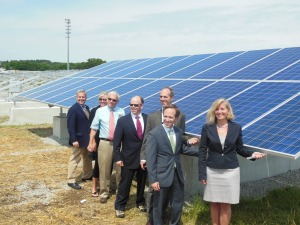 City officials pose outside Scituate, MA's 3 MW solar array that powers all city-owned facilities.
