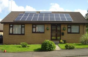 Even modest homes can benefit from rooftop solar. The dual-use panels on this house generate both electricity and heat.