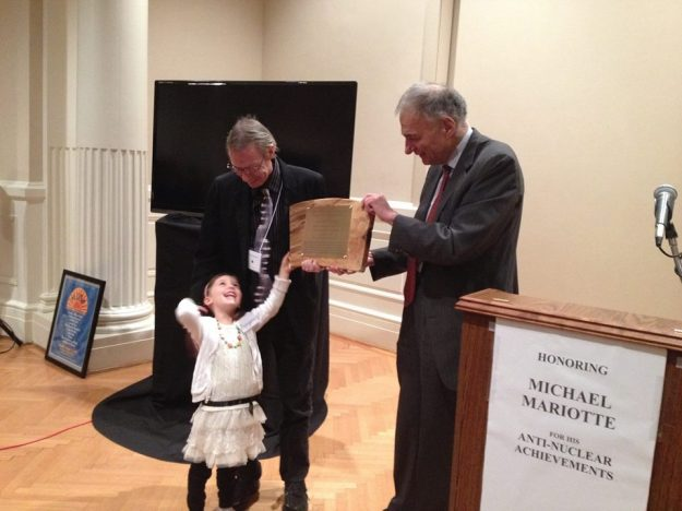 Michael Mariotte and daughter Zoryana receive lifetime achievement award from Ralph Nader, November 10, 2014.