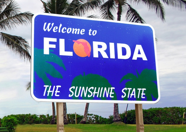 """Perhaps the most misleading state welcoming sign ever--at least if you think """"sunshine"""" should equal solar power."""
