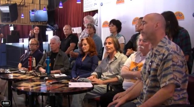 Bonnie Raitt, Jackson Browne, Graham Nash, et al, at a press conference before the August 2011 Musicians United for Safe Energy concert in Mountain View, California. They're talking about nuclear power, not chord changes or stage decor.