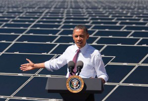 President Obama talks energy behind a backdrop of solar panels.