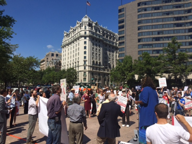 Washington DC residents rally outside the District Building September 17, 2015 against Exelon's proposed takeover of Pepco.